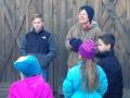 Ellen teaching children how to feed turkeys