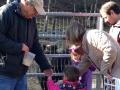 Bill helps a child with feeding animals