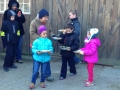 Children with the pies for turkeys